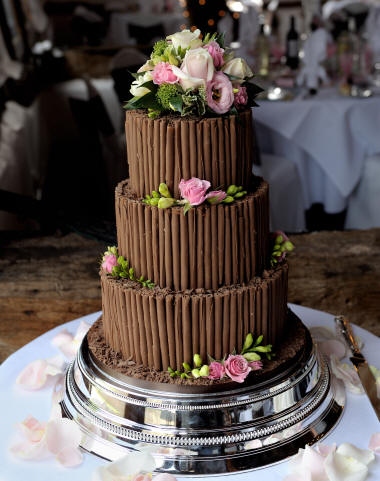Chocolate Wedding Cake decorated with fresh floral decoration by London Florist