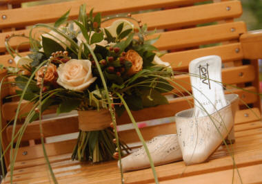 Wedding Bouquet created by London Florist displayed with Bridal Shoes